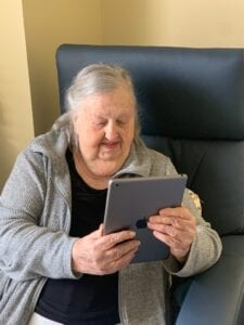 AL Resident, Ada Pursley, face timing with family