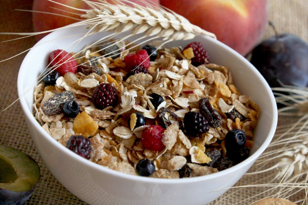 bowl of muesli topped with fruit